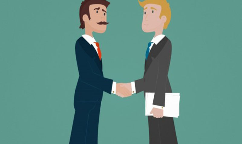 Two businessmen are shaking hands with each other.