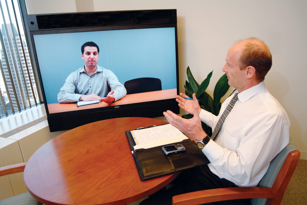 This picture is an example of video conference interview. Two people are having a conversation via video calling app.